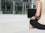 Businesswoman_outside_laptop.png