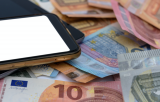 Mobile phone and euro notes